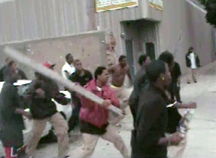 This image from video provided by WFLD Fox Chicago on Monday, Sept. 28, 2009 shows a person swinging a wooden two-by-four during a fight on Chicago's South Side on Thursday, Sept. 24, 2009. Prosecutors have charged three teenagers with first-degree murder in the beating death of Chicago student Derrion Albert who was walking home from school when this fight occurred. Family members believe the 16-year-old was fatally beaten Thursday for refusing to join a gang. But some witnesses say he was a bystander who was swept into a violent fight. (AP Photo/WFLD Fox Chicago)