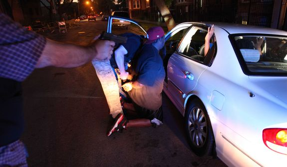 On Chicago's West side a high speed pursuit following four suspected gang members ended with the Chicago Police gang unit questioning and arresting one of them on an outstanding warrant. These pursuits are becoming more common as Chicago's homicides have ticked up over 50 percent this year over last. (AP Photo/Robert Ray)