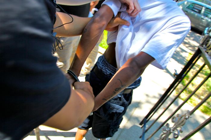 Chicago police arrest a suspect on June 5, 2012. The Chicago Police Department narcotics division has been conducting undercover investigations in order to move in on suspected drug dealers in parts of Chicago's South and West sides. (AP Photo/Robert Ray)