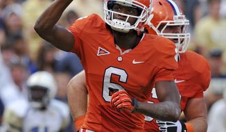 Clemson wide receiver DeAndre Hopkins gestures after a fourth-quarter touchdown reception during an NCAA college football game against Georgia Tech on Saturday, Oct. 6, 2012, at Memorial Stadium in Clemson, S.C. Clemson won 47-31. (AP Photo/ Richard Shiro)