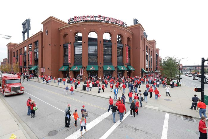 Fans arrive at the Busch Stadium for Game 3 of baseball's National League championship series between the St. Louis Cardinals and the San Francisco Giants, Wednesday, Oct. 17, 2012, in St. Louis. (AP Photo/Patrick Semansky)