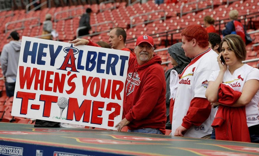 A fan holds up a sign near St. Louis Cardinals dugout before Game 3 of baseball's National League championship series against the San Francisco Giants, Wednesday, Oct. 17, 2012, in St. Louis. (AP Photo/David J. Phillip)