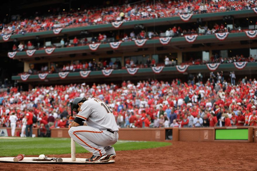 San Francisco Giants' Angel Pagan (16) prepares before the start of Game 3 of baseball's National League championship series against the St. Louis Cardinals, Wednesday, Oct. 17, 2012, in St. Louis. (AP Photo/Jeff Roberson)