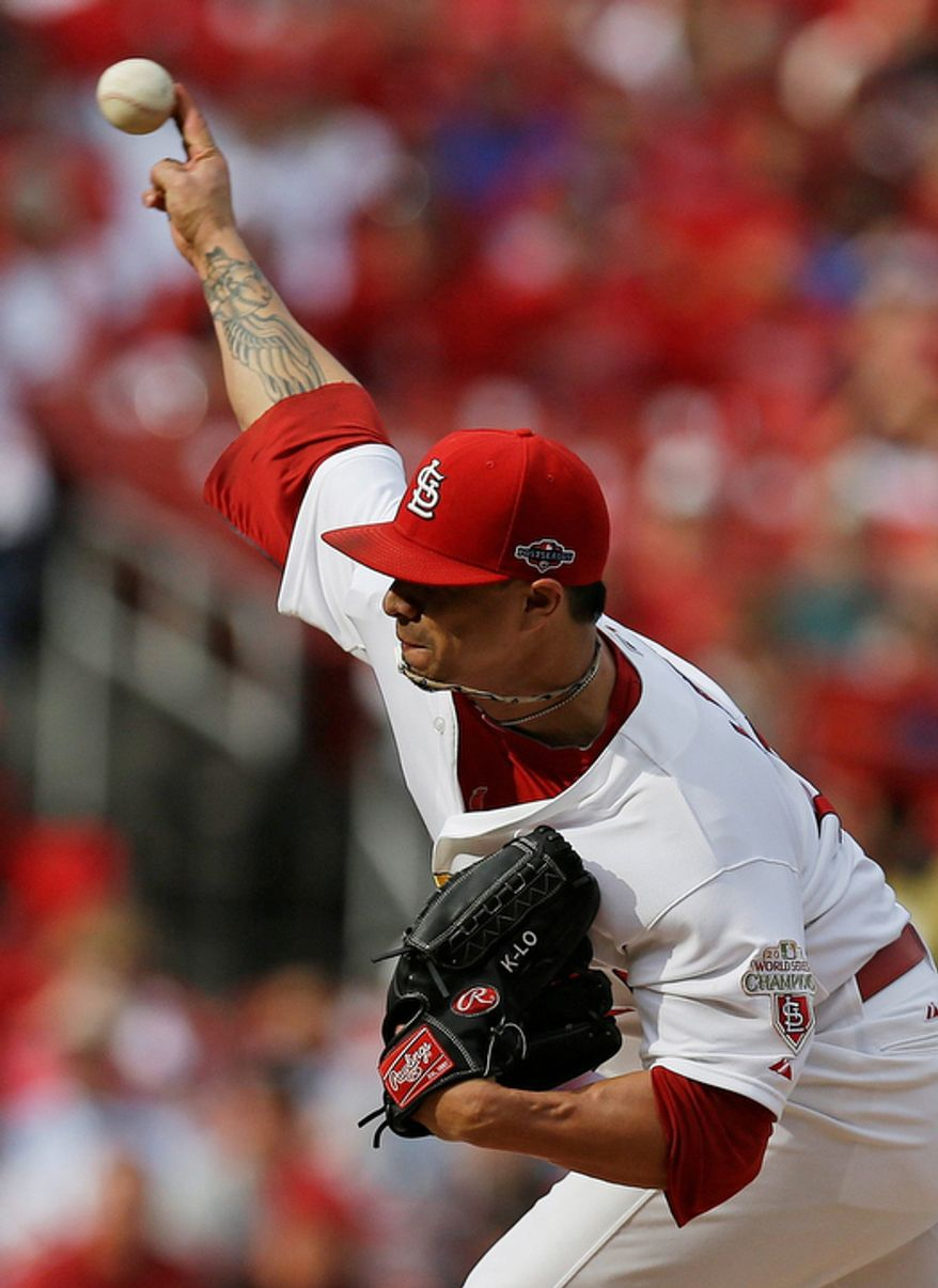 St. Louis Cardinals starting pitcher Kyle Lohse (26) pitches during the first inning of Game 3 of baseball's National League championship series against the San Francisco Giants, Wednesday, Oct. 17, 2012, in St. Louis. (AP Photo/David J. Phillip)