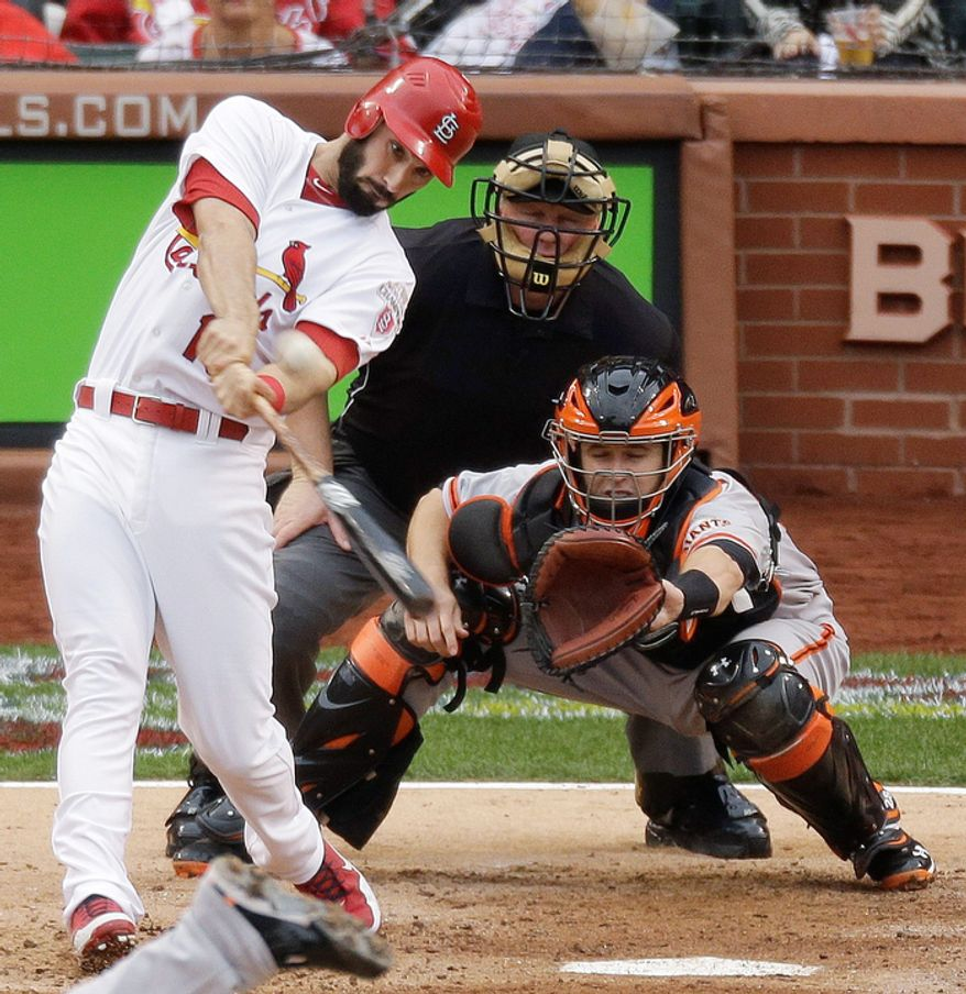 5St. Louis Cardinals' Matt Carpenter (13) hits a two-run home run during the third inning of Game 3 of baseball's National League championship series against the San Francisco Giants, Wednesday, Oct. 17, 2012, in St. Louis. (AP Photo/Mark Humphrey)