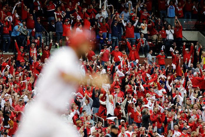 Fans celebrate after St. Louis Cardinals' Matt Carpenter, foreground, hit a two-run home run against the San Francisco Giants during the third inning of Game 3 of baseball's National League championship series, Wednesday, Oct. 17, 2012, in St. Louis. (AP Photo/St. Louis Post-Dispatch, Chris Lee)  EDWARDSVILLE INTELLIGENCER OUT; THE ALTON TELEGRAPH OUT