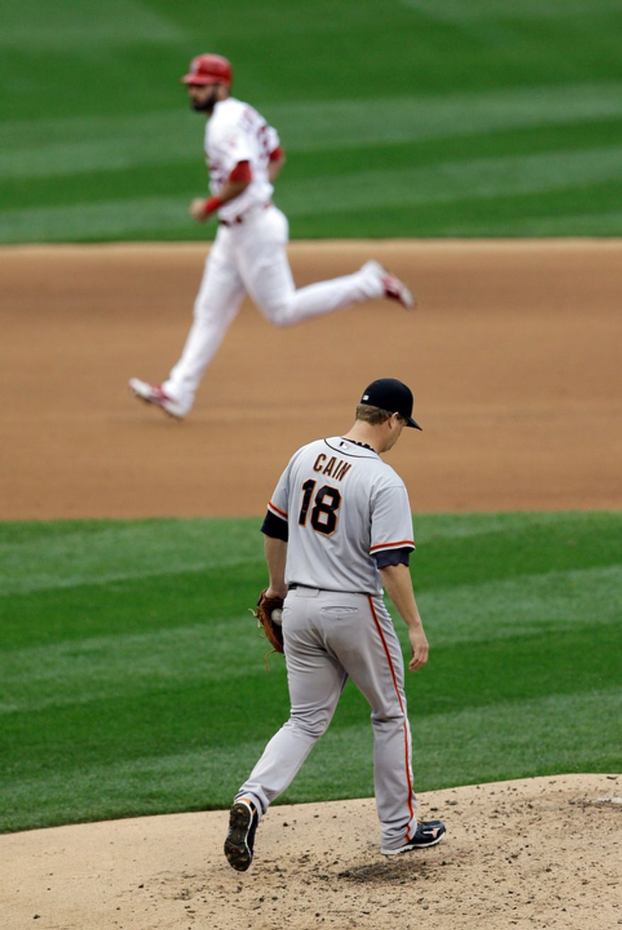 San Francisco Giants starting pitcher Matt Cain (18) reacts as St. Louis Cardinals' Matt Carpenter (13) runs the bases as he hit a two-run home run during the third inning of Game 3 of baseball's National League championship series, Wednesday, Oct. 17, 2012, in St. Louis. (AP Photo/Patrick Semansky)