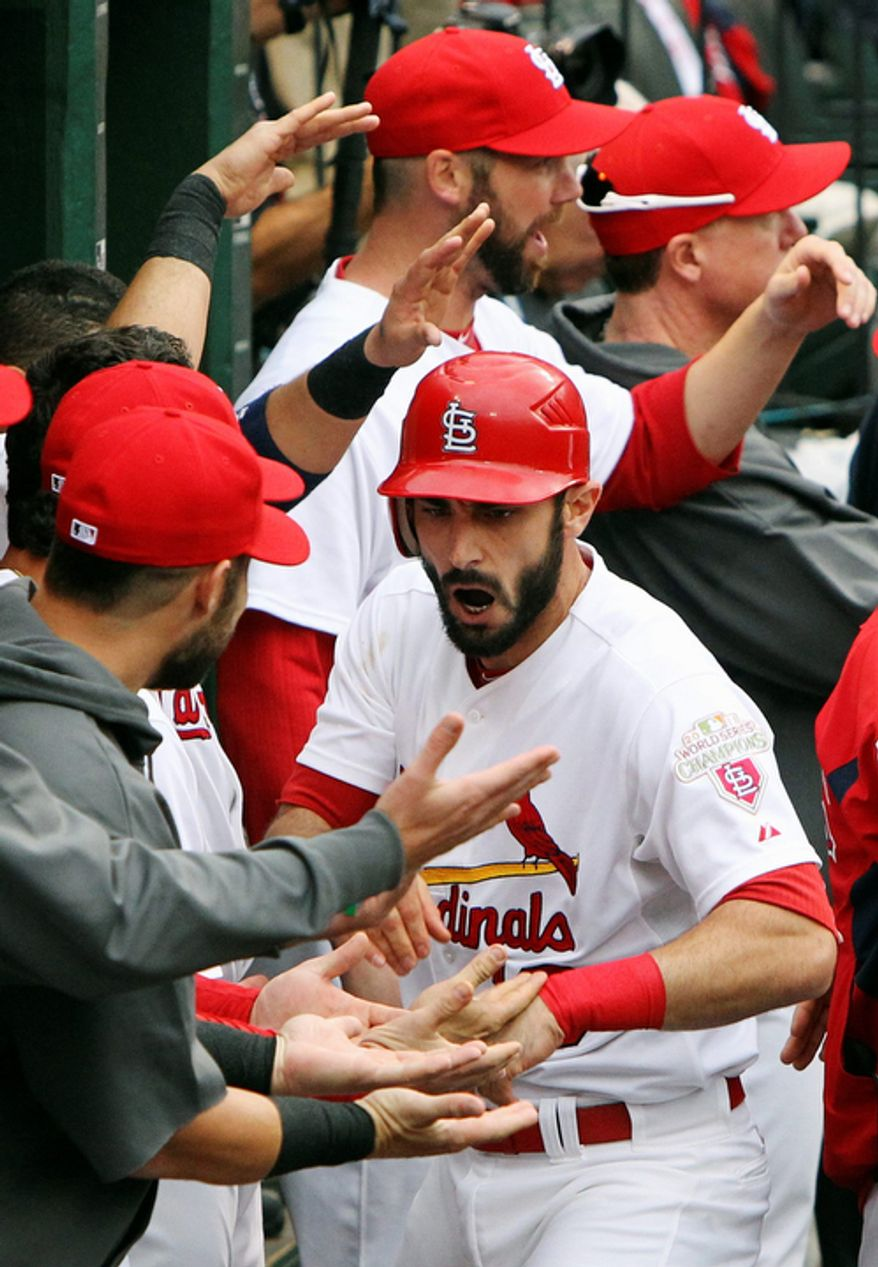 St. Louis Cardinals' Matt Carpenter is congratulated by teammates in the dugout after hitting a two-run home run against the San Francisco Giants during the third inning of Game 3 of baseball's National League championship series, Wednesday, Oct. 17, 2012, in St. Louis. (AP Photo/St. Louis Post-Dispatch, Chris Lee)  EDWARDSVILLE INTELLIGENCER OUT; THE ALTON TELEGRAPH OUT