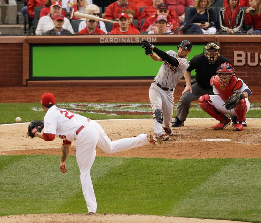 San Francisco Giants' Gregor Blanco (7) breaks his bat as he hits a foul ball during the sixth inning of Game 3 of baseball's National League championship series against the St. Louis Cardinals, Wednesday, Oct. 17, 2012, in St. Louis. (AP Photo/Mark Humphrey)