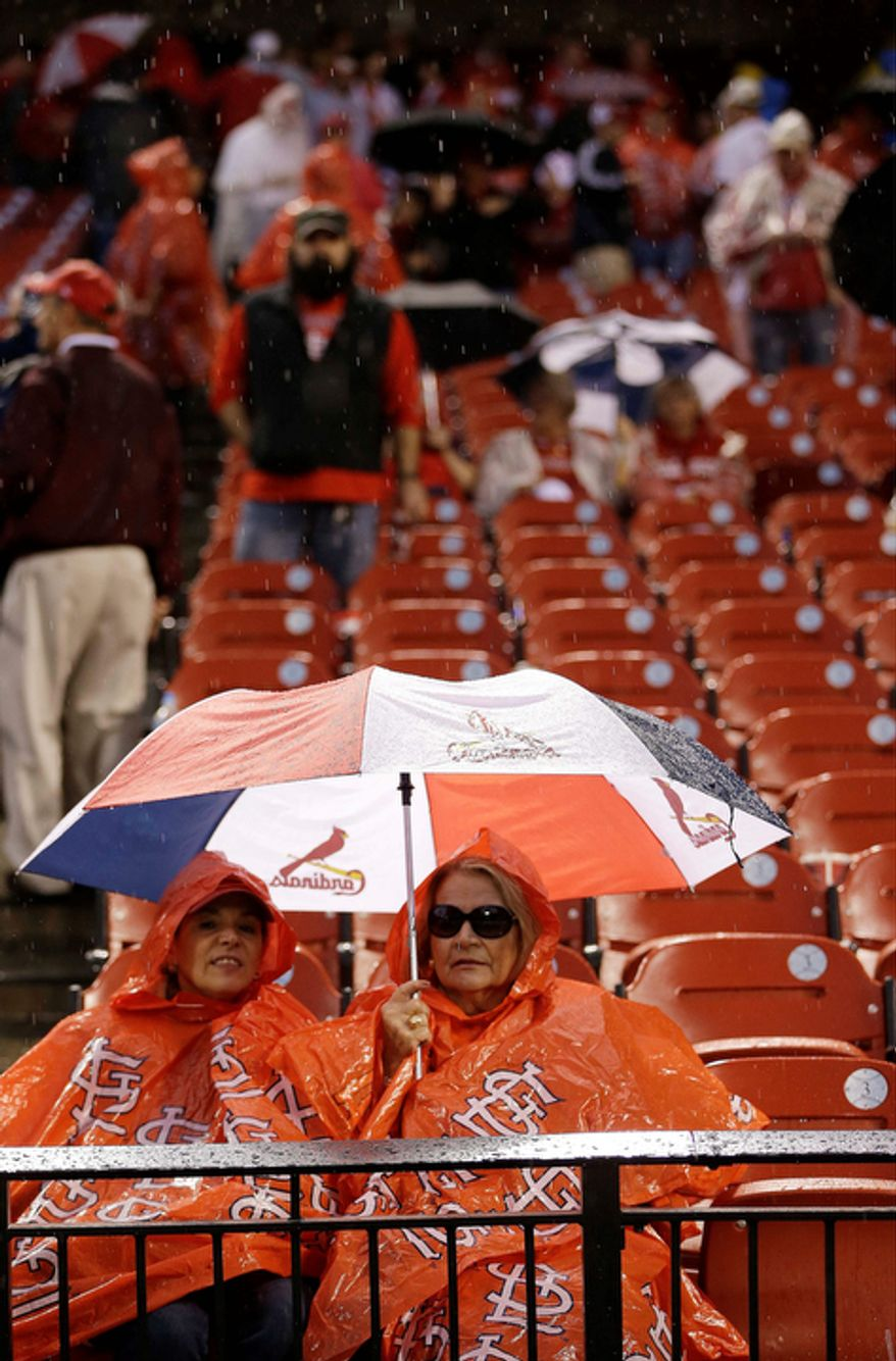 Some fans leave their seats during a rain delay of Game 3 of baseball's National League championship series between the St. Louis Cardinals and the San Francisco Giants, Wednesday, Oct. 17, 2012, in St. Louis. (AP Photo/David J. Phillip)