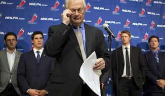 "NHL Players' Association executive director Donald Fehr (center) glances at his notes as he stands in front of players, including Pittsburgh Penguins' Sidney Crosby (second from left), following collective bargaining talks in Toronto on Oct. 18, 2012. NHL Commissioner Gary Bettman received three counter-proposals from the players' association on Thursday and left the negotiating table ""thoroughly disappointed,"" further shrinking the possibility of a full hockey regular season. (Associated Press/The Canadian Press)"