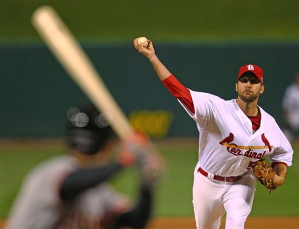 St. Louis Cardinals starting pitcher Adam Wainwright throws during the first inning of Game 4 of baseball's National League Championship Series against the San Francisco Giants Thursday, Oct. 18, 2012, in St. Louis. (AP Photo/Dilip Vishwanat, Pool)