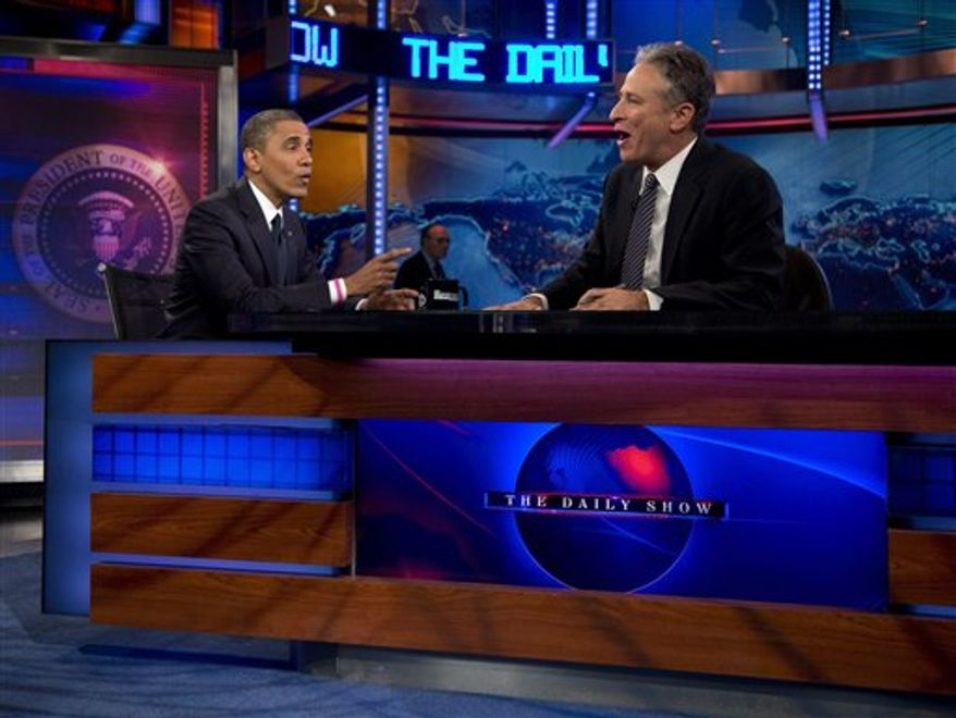 """President Obama talks with host Jon Stewart during a taping of """"The Daily Show With Jon Stewart"""" in New York on Oct. 18, 2012. (Associated Press) **FILE**"""