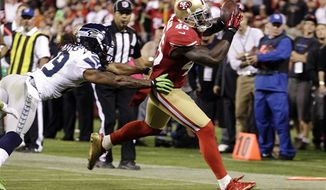 San Francisco 49ers tight end Delanie Walker (46) scores on a 12-yard touchdown reception past Seattle Seahawks free safety Earl Thomas (29) during the third quarter of an NFL game in San Francisco, Thursday, Oct. 18, 2012. (AP Photo/Ben Margot)