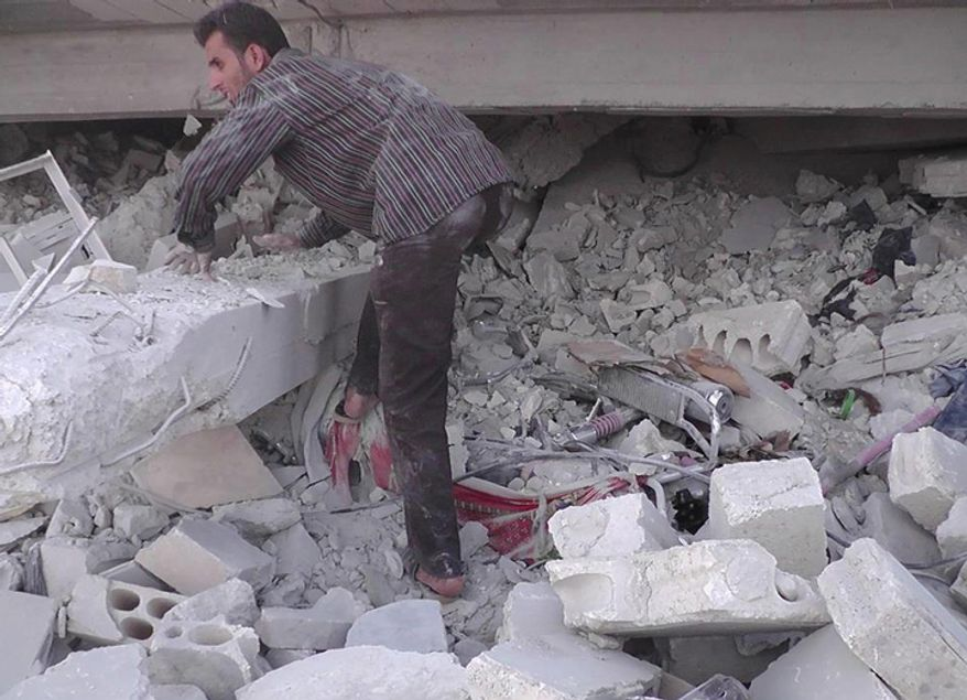 In this Wednesday, Oct. 17, 2012 photo, citizen journalism image provided by Edlib News Network, ENN, which has been authenticated based on its contents and other AP reporting, a Syrian man searches for people from under the rubble of a building that was destroyed by a Syrian force airstrike, at Kfar Nebel town, in Idlib province, northern Syria. (AP Photo/Idlib News Network ENN)