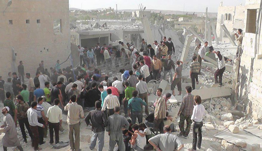 In this Wednesday, Oct. 17, 2012 photo, citizen journalism image provided by Edlib News Network, ENN, which has been authenticated based on its contents and other AP reporting, Syrian citizens gather to rescue people from under the rubble of a building that was destroyed from a Syrian force airstrike, at Kfar Nebel town, in Idlib province, northern Syria. (AP Photo/Idlib News Network ENN)