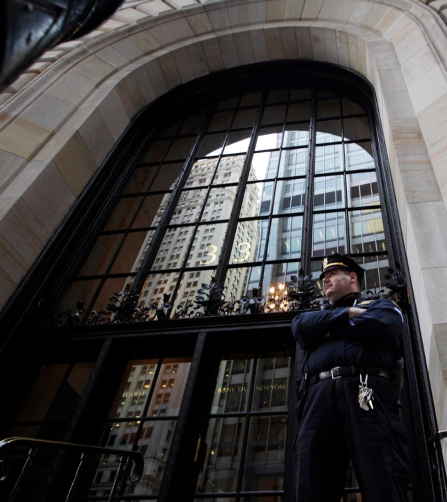 A Federal Reserve police officer stands in front of the Federal Reserve Building Wednesday, Oct. 17, 2012, in New York. Federal authorities on Wednesday arrested a Bangladeshi man they said was plotting to blow up the Federal Reserve building in Manhattan, just blocks from the World Trade Center site. Quazi Mohammad Rezwanul Ahsan Nafis, 21, was arrested in a sting operation Wednesday morning after he parked a van filled with what he believed were explosives outside the building and tried to detonate it in a suicide mission, authorities said. (AP Photo/Frank Franklin II)