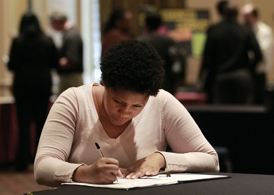 Job hunter Bessie Soley of Locust Grove, Ga., fills out an employment application at the National Job Fair in Atlanta on Wednesday, Oct. 3, 2012. (AP Photo/John Bazemore)