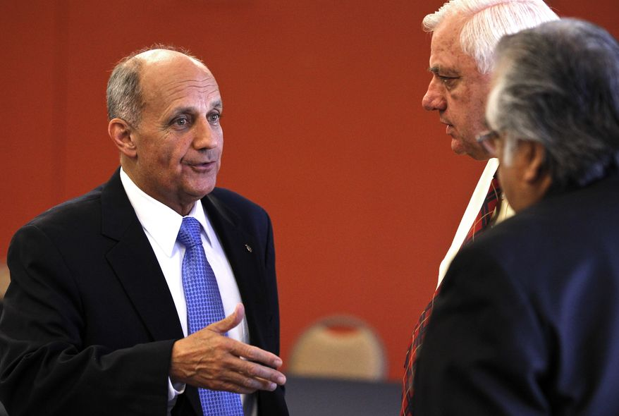 Arizona Senate candidate Richard Carmona speaks Oct. 18, 2012, with attendees prior to a debate in Chandler, Ariz., against Republican Rep. Jeff Flake. (Associated Press)