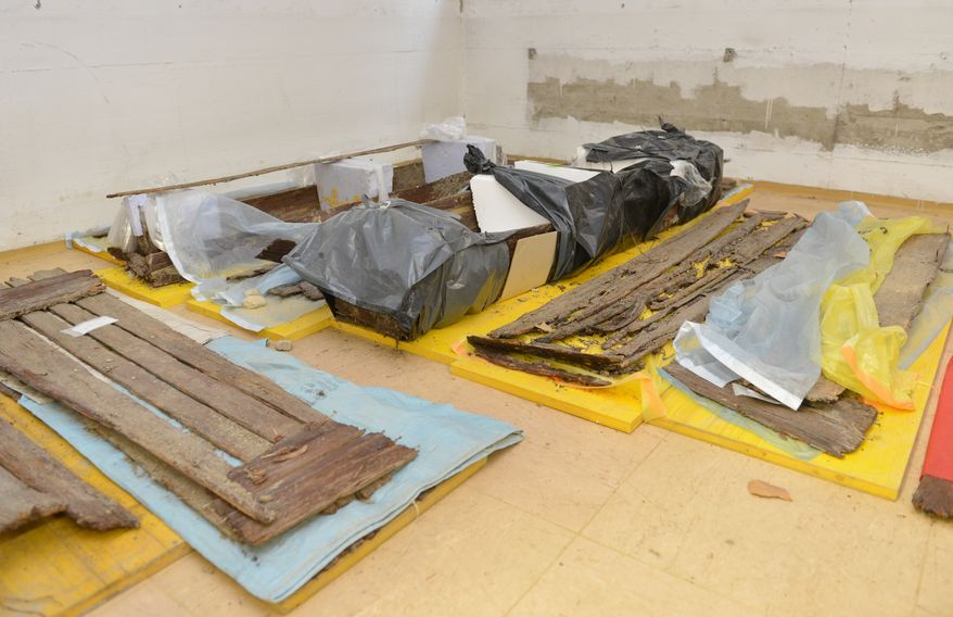 **FILE** Remains of coffins are seen Oct. 8, 2012, in a basement of the hospital in Hall near Innsbruck, Austria. The Nazi-era psychiatric patients were demeaned, starved, brutalized, and left to die. More than half, say those involved, suffered from broken ribs and other bone fractures from blows likely dealt by hospital personnel. (Associated Press)