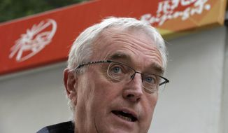 **FILE** Pat McQuaid, president of the International Cycling Union, speaks during an interview after the fourth stage of the Tour of Beijing in Beijing on Oct. 12, 2012. (Associated Press)
