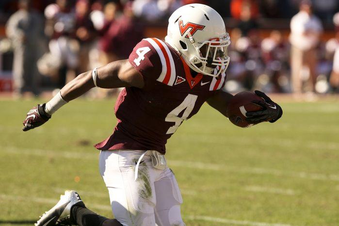 J. C. Coleman (4) breaks for an 86 yard touchdown run in the fourth quarter of an NCAA college football game against Duke in Blacksburg Va. Saturday Oct. 13, 2012. Virginia Tech won 41-20. (AP Photo / The Roanoke Times, Matt Gentry)