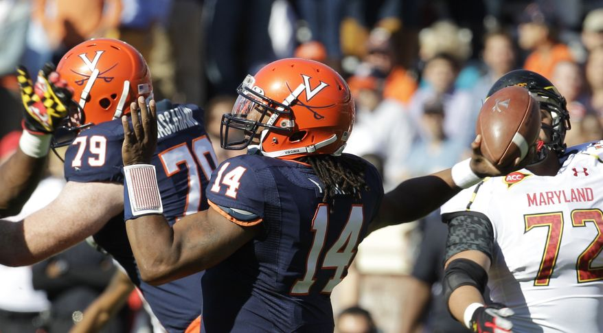 Virginia quarterback Phillip Sims tosses a pass during an NCAA college football game against Maryland in Charlottesville, Va., Saturday, Oct. 13, 2012. Maryland won 27-20. (AP Photo/Steve Helber)