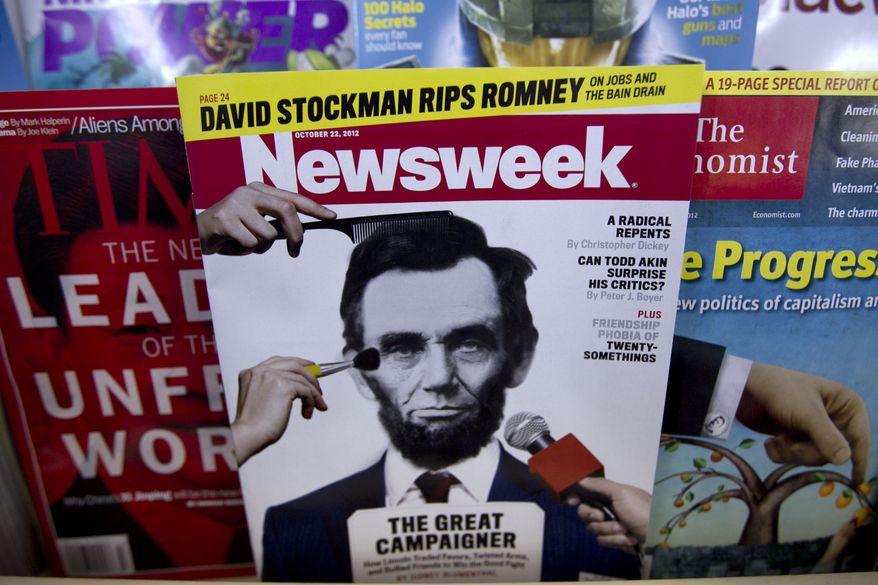 **FILE** A copy of Newsweek is seen Oct. 18, 2012, at Joe's Smoke Shop in Portland, Maine. (Associated Press)
