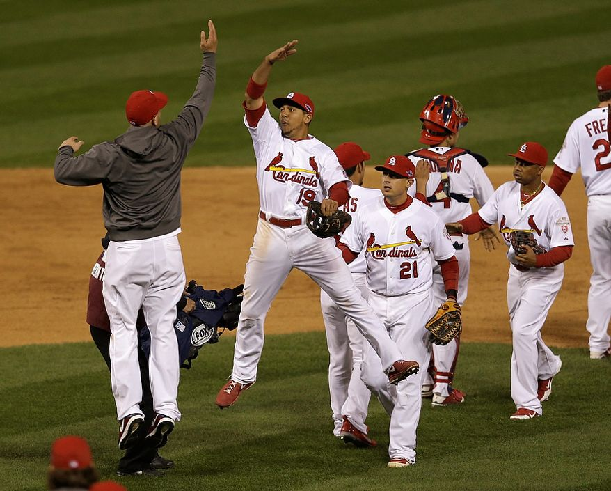 St. Louis Cardinals' Jon Jay (19) and a teammate celebrate after Game 4 of the National League Championship Series against the San Francisco Giants on Oct. 18, 2012, in St. Louis. The Cardinals won 8-3 to take a 3-1 lead in the series. (Associated Press)