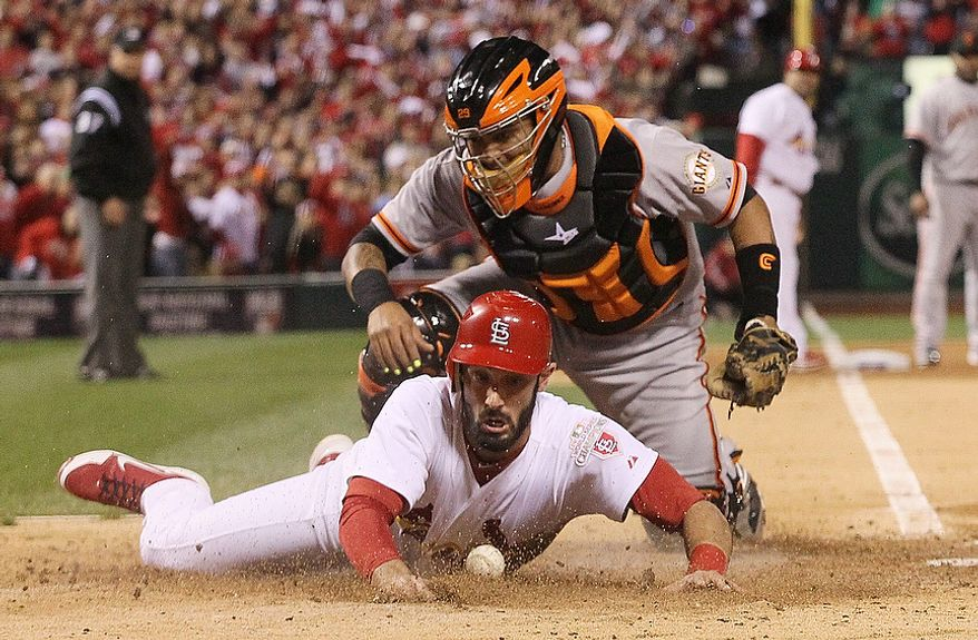 St. Louis Cardinals 1B Matt Carpenter scores on a single by Matt Holliday as San Francisco catcher Hector Sanchez is unable to handle the throw in the fifth inning of Game 4 of the National League Championship Series on Oct. 18, 2012, in St. Louis. (Associated Press/St. Louis Post-Dispatch)