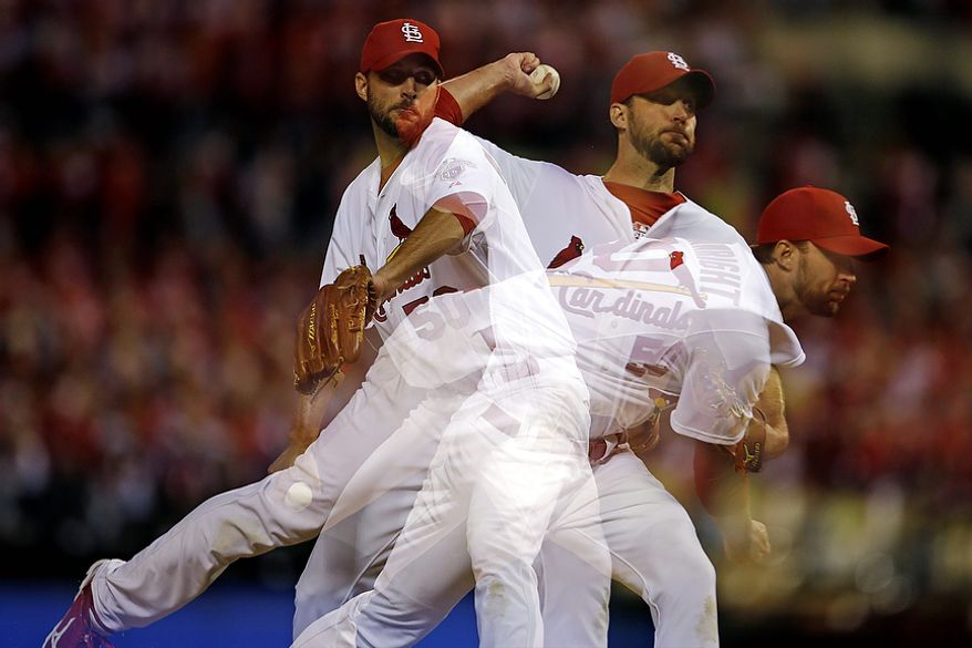 This multiple-exposure image photo shows St. Louis Cardinals starting pitcher Adam Wainwright throw during the sixth inning of Game 4 of the National League Championship Series against the San Francisco Giants on Oct. 18, 2012, in St. Louis. (Associated Press)