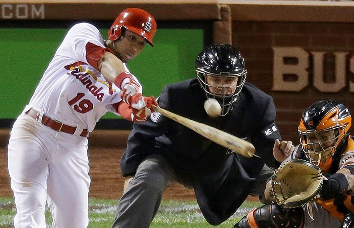 St. Louis Cardinals' Jon Jay hits a two-run double during the sixth inning of Game 4 of the National League Championship Series against the San Francisco Giants on Oct. 18, 2012, in St. Louis. (Associated Press)