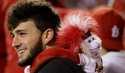 Ryan Calvird of Farmington, Mo., gets ready for the start of Game 4 of the National League Championship Series between the San Francisco Giants and the St. Louis Cardinals on Oct. 18, 2012, in St. Louis. (Associated Press)