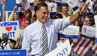 **FILE** Republican presidential candidate Mitt Romney waves to supporters as he arrives Oct. 17, 2012, for a rally at Tidewater Community College in Chesapeake, Va. (Associated Press)
