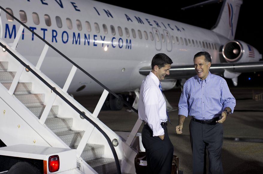 Republican presidential candidate, former Massachusetts Gov. Mitt Romney shares a laugh with his vice presidential running mate Rep. Paul Ryan, R-Wis., after greeting him at Daytona Beach International Airport for a joint campaign event on Friday, Oct. 19, 2012 in Daytona Beach, Fla. (AP Photo/ Evan Vucci)