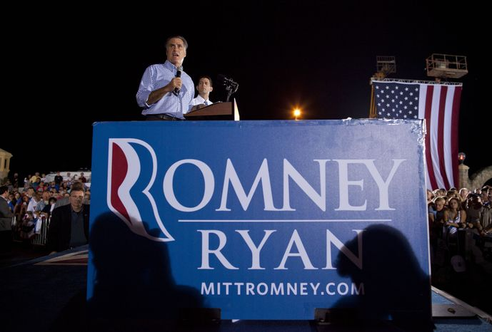 ** FILE ** Republican presidential candidate, former Massachusetts Gov. Mitt Romney, left, speaks as vice presidential running mate Rep. Paul Ryan, R-Wis., watches during a campaign rally on Friday, Oct. 19, 2012 in Daytona Beach, Fla. (AP Photo/ Evan Vucci)