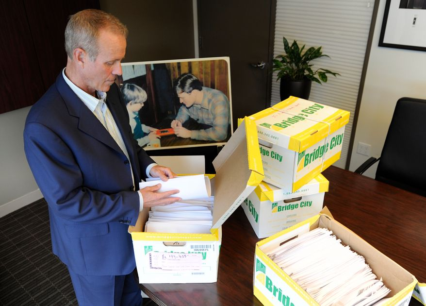 In this Tuesday, Oct., 16, 2012 photo, Portland attorney Kelly Clark examines some of the 14,500 pages of previously confidential documents created by the Boy Scouts of America concerning child sexual abuse within the organization, in preparation for releasing the documents Thursday, Oct. 18, in his office in Portland, Ore. The Boy Scouts of America fought to keep those files confidential. (AP Photo/Greg Wahl-Stephens)