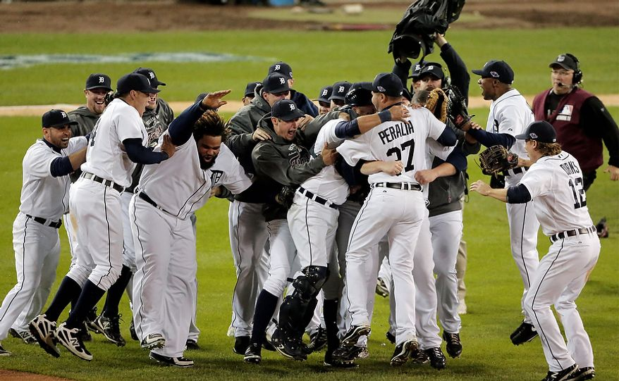 The Detroit Tigers celebrate after winning Game 4 of the American League Championship Series, 8-1, against the New York Yankees on Oct. 18, 2012, in Detroit. The Tigers move on to the World Series. (Associated Press)