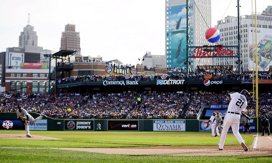 Detroit Tigers OF Delmon Young hits an RBI single in the first inning off New York Yankees pitcher CC Sabathia during Game 4 of the American League Championship Series on Oct. 18, 2012, in Detroit. The Tigers won, 8-1, to move on to the World Series. (Associated Press)