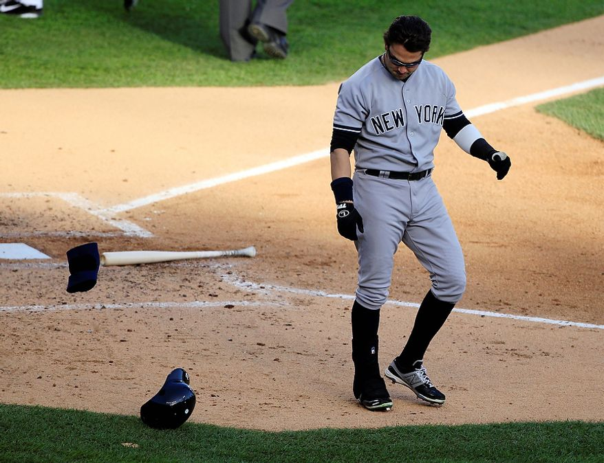 New York Yankees' Nick Swisher leaves home plate after striking out to end the third inning of Game 4 of the American League Championship Series against the Detroit Tigers on Oct. 18, 2012, in Detroit. The Tigers won, 8-1, to move on to the World Series. (Associated Press)