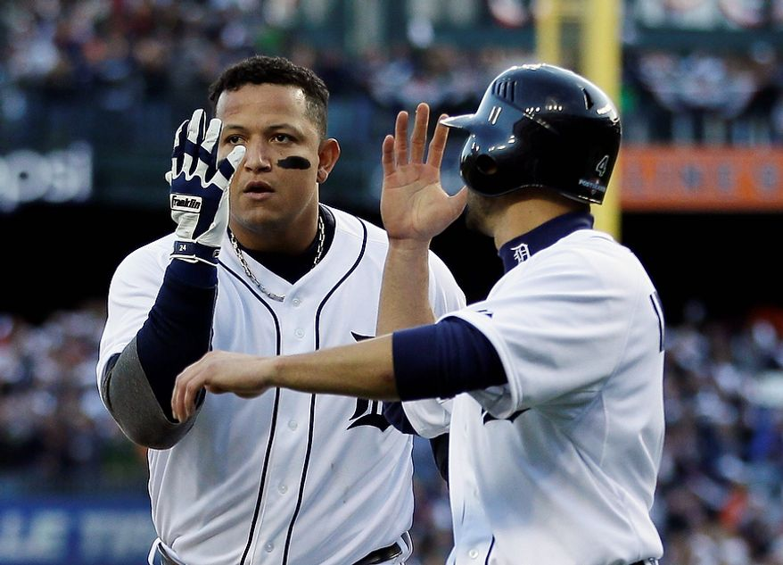 Detroit Tigers' Miguel Cabrera (left) and Omar Infante celebrate after Cabrera hit a two-run home run in the fourth inning of Game 4 of the American League Championship Series against the New York Yankees on Oct. 18, 2012, in Detroit. The Tigers won, 8-1, to move on to the World Series. (Associated Press)