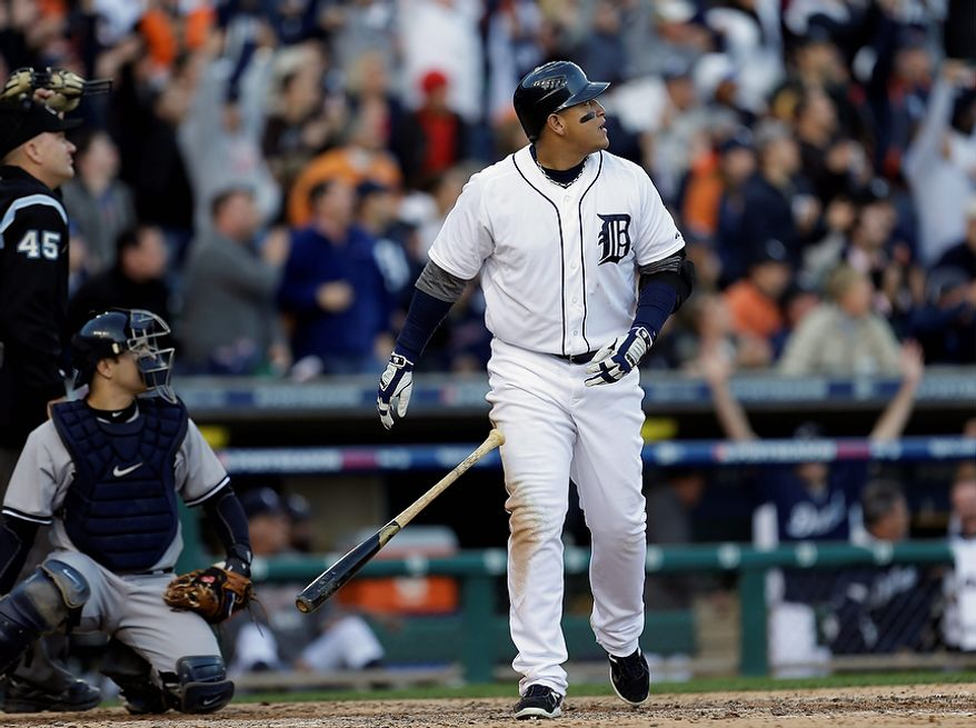 Detroit Tigers' Miguel Cabrera watches his two-run home run in the fourth inning of Game 4 of the American League Championship Series against the New York Yankees on Oct. 18, 2012, in Detroit. The Tigers won, 8-1, to move on to the World Series. (Associated Press)