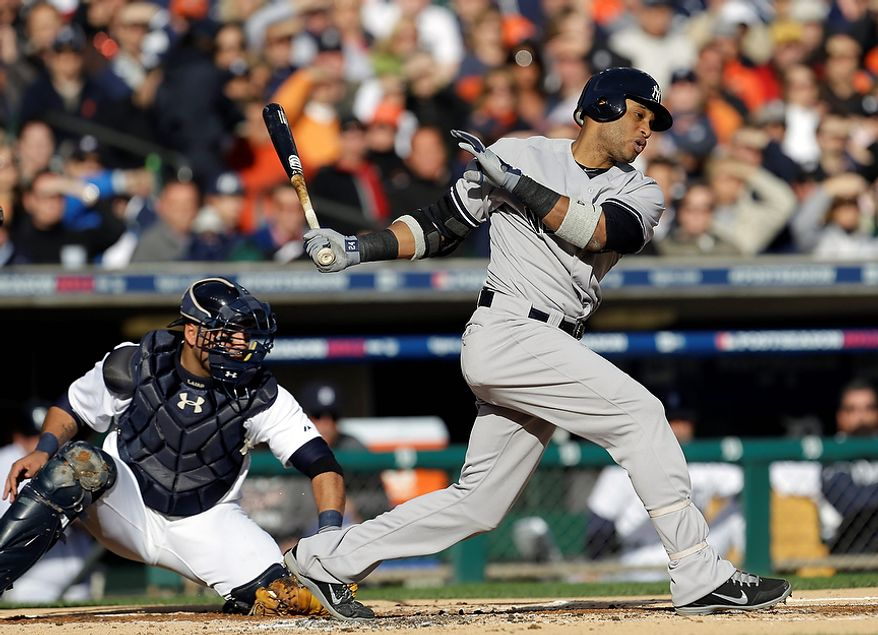 New York Yankees' Robinson Cano strikes out swinging in the first inning as Detroit Tigers catcher Gerald Laird reaches for the ball during Game 4 of the American League championship series on Oct. 18, 2012, in Detroit. (Associated Press)