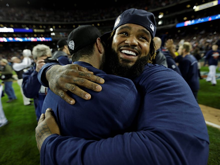 Detroit Tigers' Prince Fielder celebrates with a teammate after winning Game 4 of the American League Championship Series, 8-1, against the New York Yankees, on Oct. 18, 2012, in Detroit. The Tigers move on to the World Series. (Associated Press)