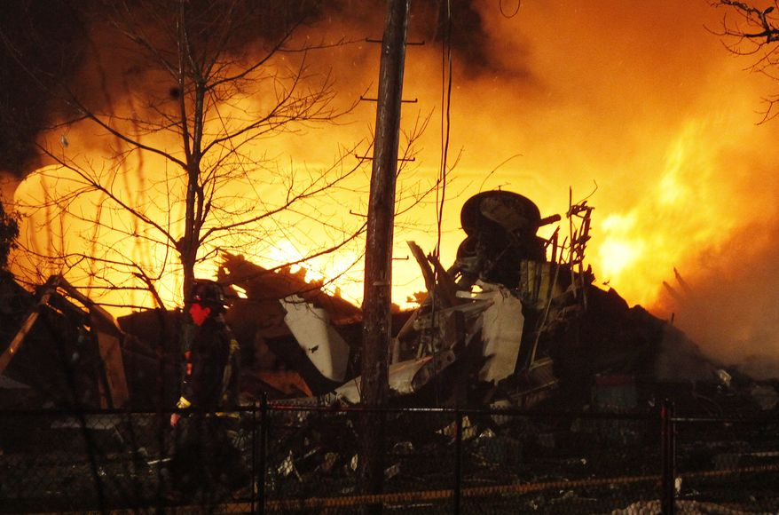 **FILE** Continental Airlines Flight 3407 operated by Manassas, Va.-based Colgan Air, burns after crashing into a house in Clarence Center, N.Y., on Feb. 12, 2009. (Associated Press)