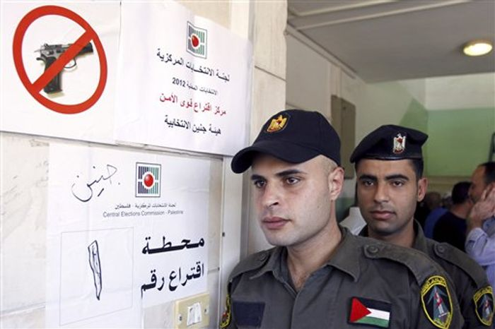 ** FILE ** Palestinian security officers wait to cast their early votes during local elections at a polling station in the West Bank town of Jenin, Thursday, Oct. 18, 2012. They cast an early vote ahead of local elections that are to take place across the West Bank on Oct. 20, 2012, in the first such polls since 2006. (AP Photo/Mohammed Ballas)