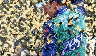 Matt Kenseth stands on his car in Victory Lane after winning the NASCAR Sprint Cup Series auto race at Kansas Speedway, Sunday, Oct. 21, 2012, in Kansas City, Kan. (AP Photo/Autostock, Matthew T. Thacker) MANDATORY CREDIT