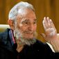 Former Cuban leader Fidel Castro speaks during a meeting with intellectuals and writers at the International Book Fair in Havana on Sunday, Feb. 10, 2012. (AP Photo/Cubadebate, Roberto Chile)