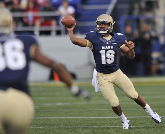 Navy quarterback Keenan Reynolds passes against Indiana during the second half of an NCAA college football game on Saturday, Oct. 20, 2012, in Annapolis, Md. Navy won 31-10. (AP Photo/Gail Burton)