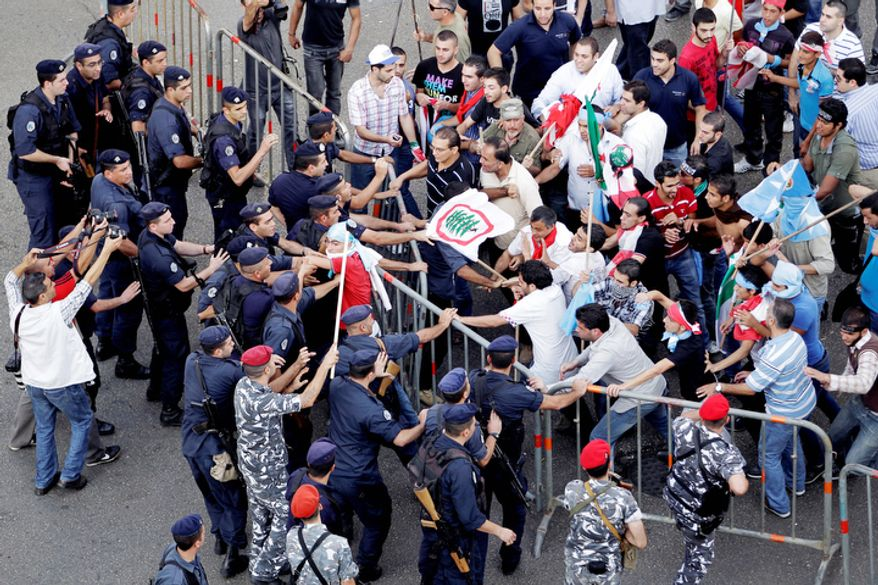 Police and protesters clash after the funeral of Brig. Gen. Wissam al-Hassan in Beirut, Lebanon, Sunday, Oct. 21, 2012. (AP Photo/Hussein Malla)